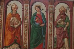 Frescos at the tomb of St. Bartolo: San Gimignano, St. Lucy, St. Nicholas of Bari.