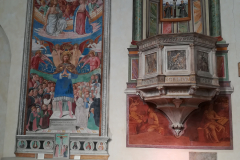 The pulpit and a fresco of St. Sebastian.