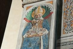 A fresco of San Gimignano holding the city.