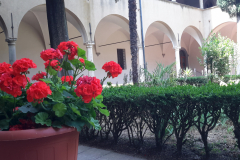 During the summer beautiful flowers bring color to the cloister.